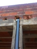 Cabeza de pilares con bajante
